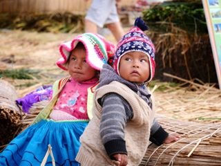 backpacking children share southamerica photography travelphotography puno uros travel spreadlove traveladdict tradition photooftheday peru portraitphotography travelgram love photographer people adventure travellingthroughtheworld discover portrait photographie photo explore backpacker