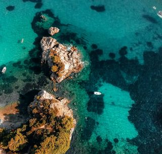mothernature filmlike rocks advisor trip beauty cometogreece vacation fimix8se greece boat bath sun beach stafylos skopelos summer drone dronephotography