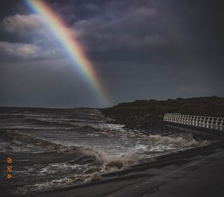 rain sun grey waves wales sea 2020 rainbow