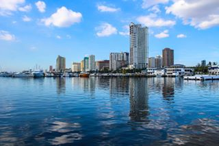 sea manila city blue urban cityscape clear cloud sky bay white buildings philippines reflection waves