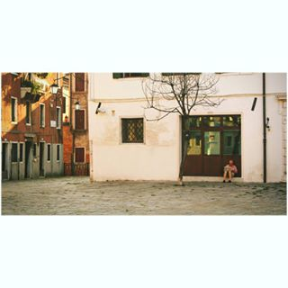 exploringthecity people colors sitting buildings spaces tree relaxing streetphotography man laptop empty walls