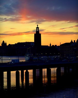 adventuretime älskarstockholm älskarsverige bridge city cityhall colorful europe explore lovestockholm rådhuset silhouette sky stockholm sunset sunsetsky sverige sweeden travel traveling water