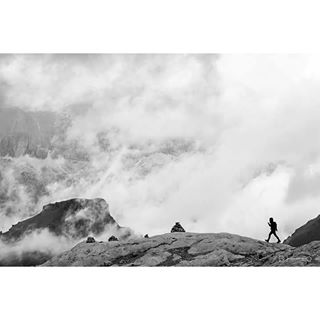 landscape perspective trekking climbing contrast nature clouds human scale hike adventure peak travel mountains explore outdoors blackandwhite ridge dolomites