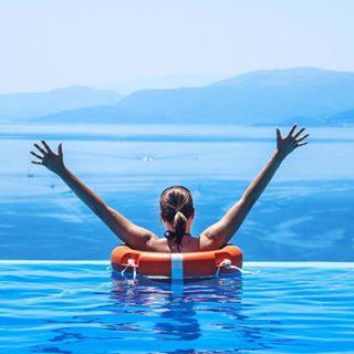 edge sea hands handsup woman swimmingpool travel greece lefkadaisland sky seimming lefkada blue edgeoftheworld water summer beautiful