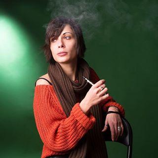 adult background beauty cigarette creative_portraits green model shot smoking stuio woman young