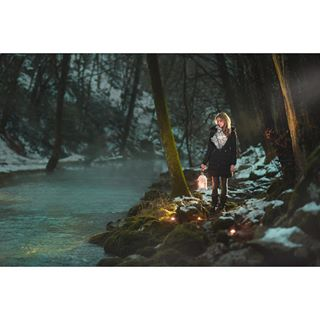 portraitphotography cyan nature girl candles beautiful lantern winterfairytale ljubljana colors forest model fashion snow dreams nikon tbt picoftheday andrazgregoric slovenia fairytale photography river art beauty inspiration instagood portrait stream magical