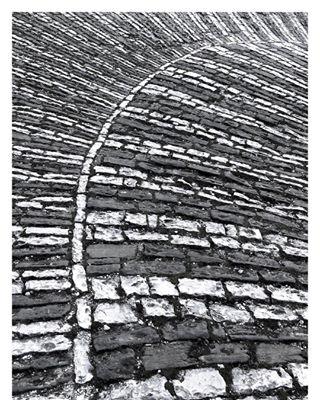 albania ancient balkan bend blackandwhite bw curve fishbones gjirokaster iphonephotography minimalism minimalist minimalistic minimalzine pianokeys road shotoniphone stone stonyroad stripes theprintswap