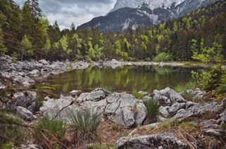 zugspitze water trees tour small shades rocks reflections of nikon near nature mountains lake holiday green eibsee clouds bike beautiful bavarian alps