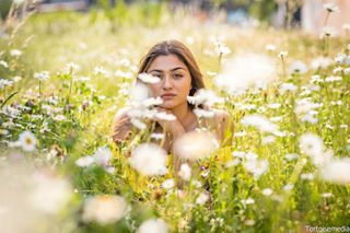 girl white photoshoot model beutiful green posing beuty grass sexy ground laying flowers