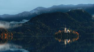 sky architecture clouds mountains sunset fall photooftheday photography love building church island autumn water fog colorful reflections fotoluce nature lake trees landscape