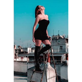 portaits_ig portraitphotography portraiture photographer ladder portraitmood portraitpage rooftop fashion portrait beautiful portrait_vision city beauty woman bluesky edgy fierce