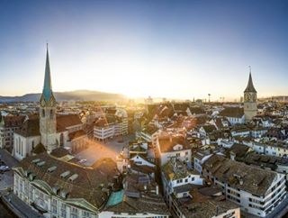 switzerland amazing sun picoftheday stunning oldtown bluesky flare beautiful colors high view sunset incredible city mavic zurich dji igers instagood church fly place