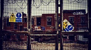 building outdoors brick architecture england old window industry wall graffiti fence abandoned security unitedkingdom city portsmouth street steel