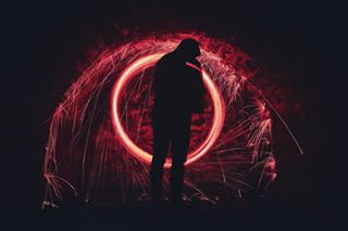 energy photooftheday bright light flame graphic dark motion insubstantial art people photography silhouette abstract danger shape