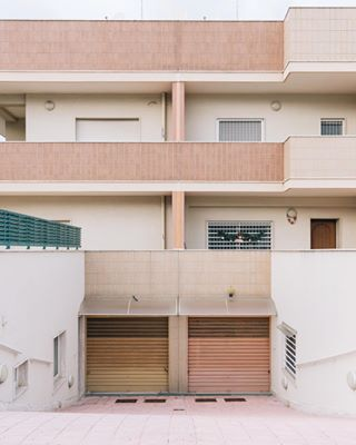 ethereal southerniraly suburbs coast pastels greysky sculpture lowerlevel monopoli domus tiles dezeen mediterranean orange minimal archdaily archeology midcentury architecture architecturedesign christmas2018 pink style bari modernisn designboom fineart ghostly puglia garage