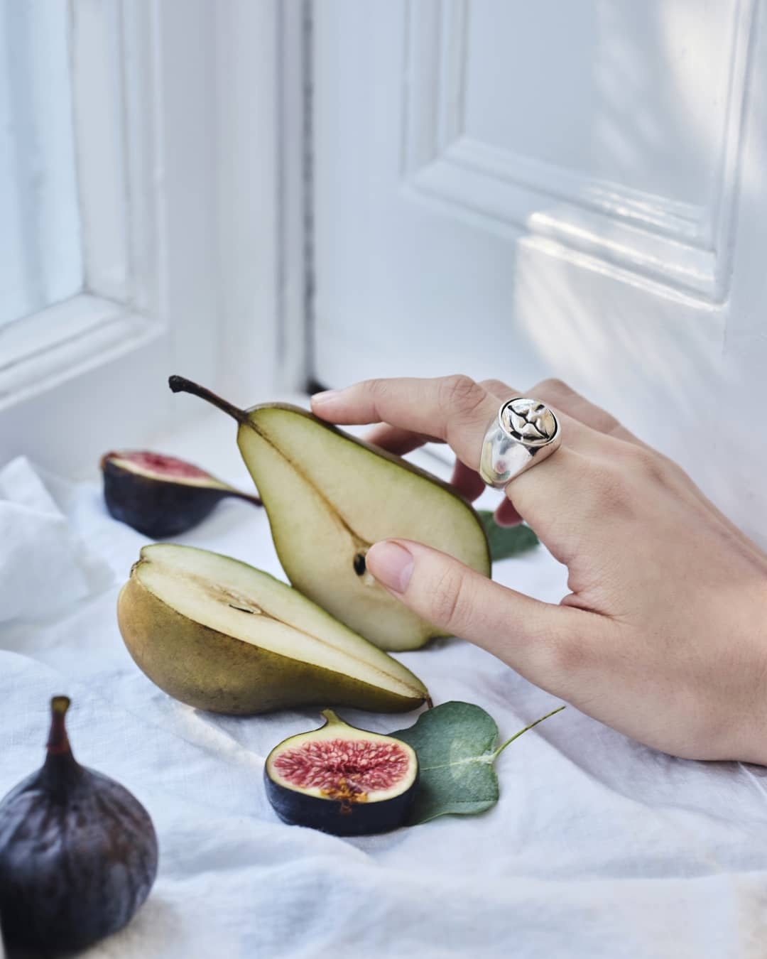mediumformatphotography pear fig figs fruit jeweller hand ring silver stylist styling style decor interiordecor photographer photography gfx50s designer furniture repostmyfujifilm fujifilm design stilllifephotographer stilllifephotography stilllife interior jewellerydesign jewellery