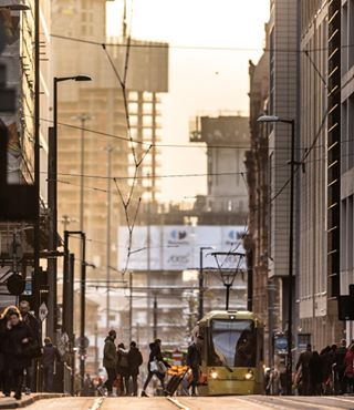 tram cityscape streetphotography wearemcr canon primelens manchester 400mm streetview bestofmcr shoppers autumnsun zoom