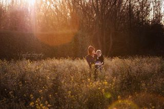 mommy wildflowers field familytime sun photographer momlife due2019 pregnancy sunflare comingsoon saturyayyy familyphotography maternityshoot momandson secondbaby