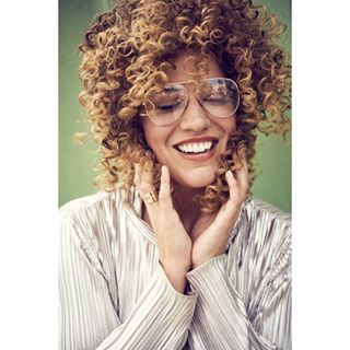 femalemodel agency styling happy portrait peoplephotography mood harbour onlocation curls icemodels glasses kultmodels hamburg fashionissue curlyhair