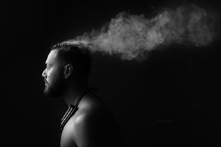 portrait portraitphotography dramaticlighting savagebackdrop bubble man lowkey smoke vapor black thundergreybackdrop studio electroniccigarette