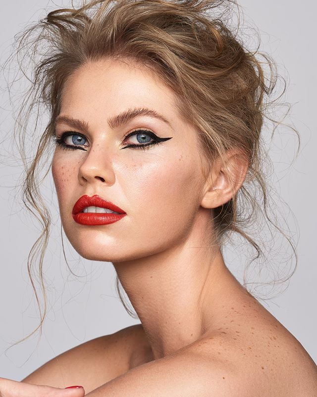 eyeliner wingedliner beautyphotography portraitphotography gennext2018 highendretouching broncolorgennext editorialbeauty updo flawlessskin dewyskin retouching broncolor liner redlips broncolorlighting flawlessmakeup makeup beauty