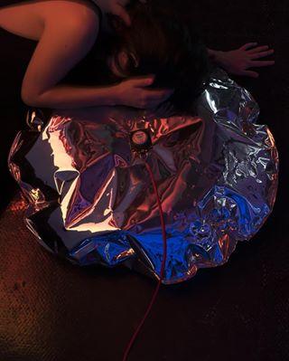 photoshoot redlight wall architecture bag design airbag color background photography photographematthieubarani canon enclosure kenzadrancourt women blackcoat inflatable projector canonphotography back brightobject designer photographer objectofdesign red