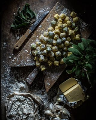 butter rustic potatoes foodstyling foodphotography darkphotography garlic gnocchi moodyphotography woodenboard foodlove sage chiaroscuro italiancountryside
