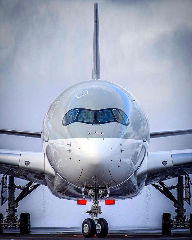 photographer runway adelaideairport qatarairways aviationphotography airbus plane a350xwb airport a350 professionalphotographer watercannonsalute touchdown aviation racoon avgeek megaplane airbuslovers landing apron qatara350 nikon aviationdaily d800