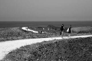 tworoads landscapephotography corner curves globalfotografia_bnw white seaside black photooftheday sky couple sea bnwaddict biancoenero road people walking seascape lines