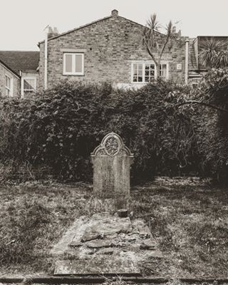 monochromatic memories ignantpicoftheday neighborhood memory cemetery monochrome tombstone monochromephotography neighbours abandoned