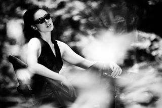 catsuit sunglasses legs blackandwhite markuslokai girl leg trees sciencefiction model dream strangeness mkfeature femmefatale photography black woman victoriabretzing nature mood blackemotion bnw_planet schwarzweiss woods