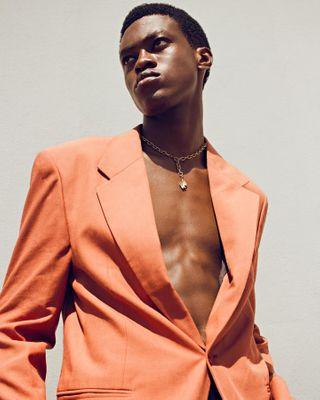 blazerslimfit colours malemodels nigerianphotographers lagos springfashion photography fashionphotography femalephotographers portrait_perfection 24mm editorialmodel orange davidiwuu