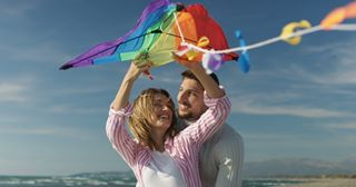 man beach warm people fashion sport family 8k sea landscape love red friendship lit couple girl dream color woman helium8k happiness sky romance fun shutterstock autumn play two shutterstockcontributors kite