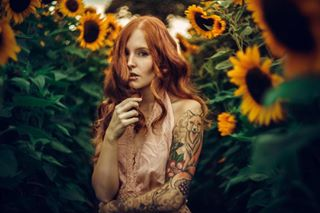sunlight ginger tattoo portraitpage sunflower portraitphotography freckles portrait redhead portrait_perfection colorfull redhair fox tattoos