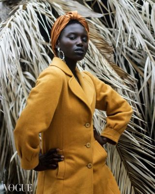 staysafe sky blackgirl gay afrogirl instagram sustainablefashion face fashion swimwear fit woman picoftheday photooftheday ootd beautiful model pose tyrabanks sustainability fashionphotography skin inspiration melanin afro orange