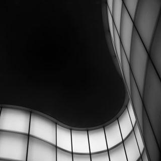 abstract architecturephotography blackandwhitephotography glasswalls undulate waving