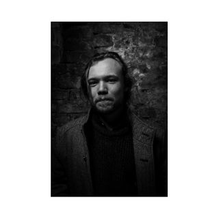 photoshoot blackandwhitephotography portrait cellar brickwall coat flashlight studiolight dark bier