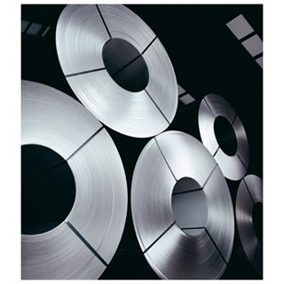 reelsofsteel industrialphotographer stacks reels sheffieldsteel heavyindustry shiny industrialphotography sheetsteel metallic steel rolls