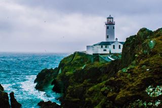 lighthouse oceanview photography rocks erasmus ireland ocean