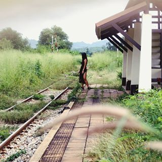 kanchanaburi oneperson railway thailand train waiting