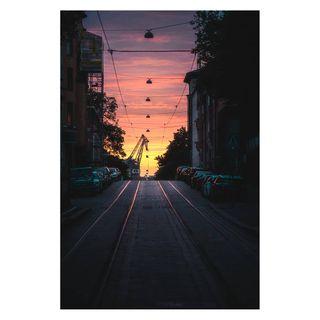 moodyphotography streetphotography featuredphotographs colors_of_the_day bestinhel helsinki helsinkicity sonya7 sony glowing road crane sonyphotography sunsetphotography sunset tramtracks tram